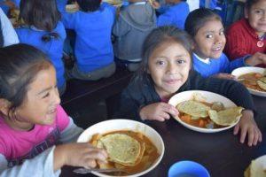 Guatemalan girls eating a meal at school