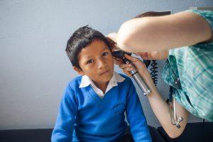 Doctor using Otoscope