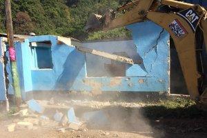 Demolition of original adobe-brick building