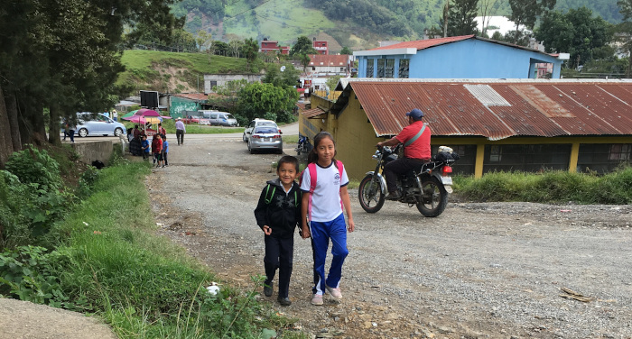 Keyser and his sister walking to school