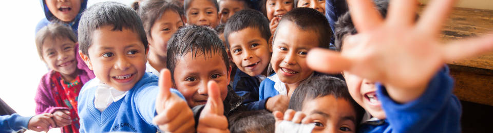 Guatemalan Kids with Smiles and Thumbs Up