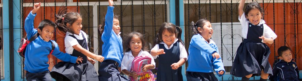 A class of young Guatemalan children jumping for joy