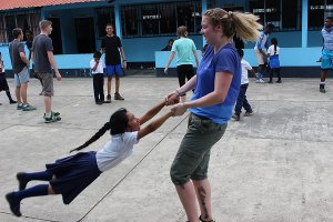 Short-term team member playing with student
