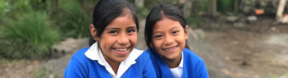 Two impact ministries students in school uniform with big smiles