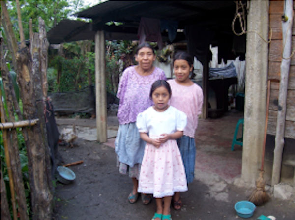 Evelin with her mother and sister