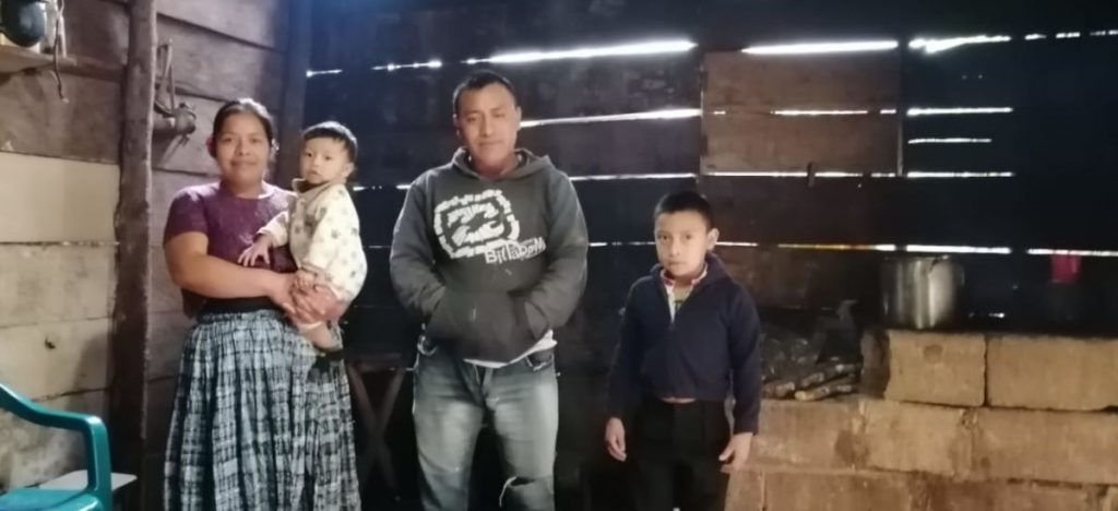 Jhon's family in their home